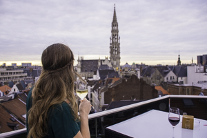 Me drinking wine on a Brussels roofop